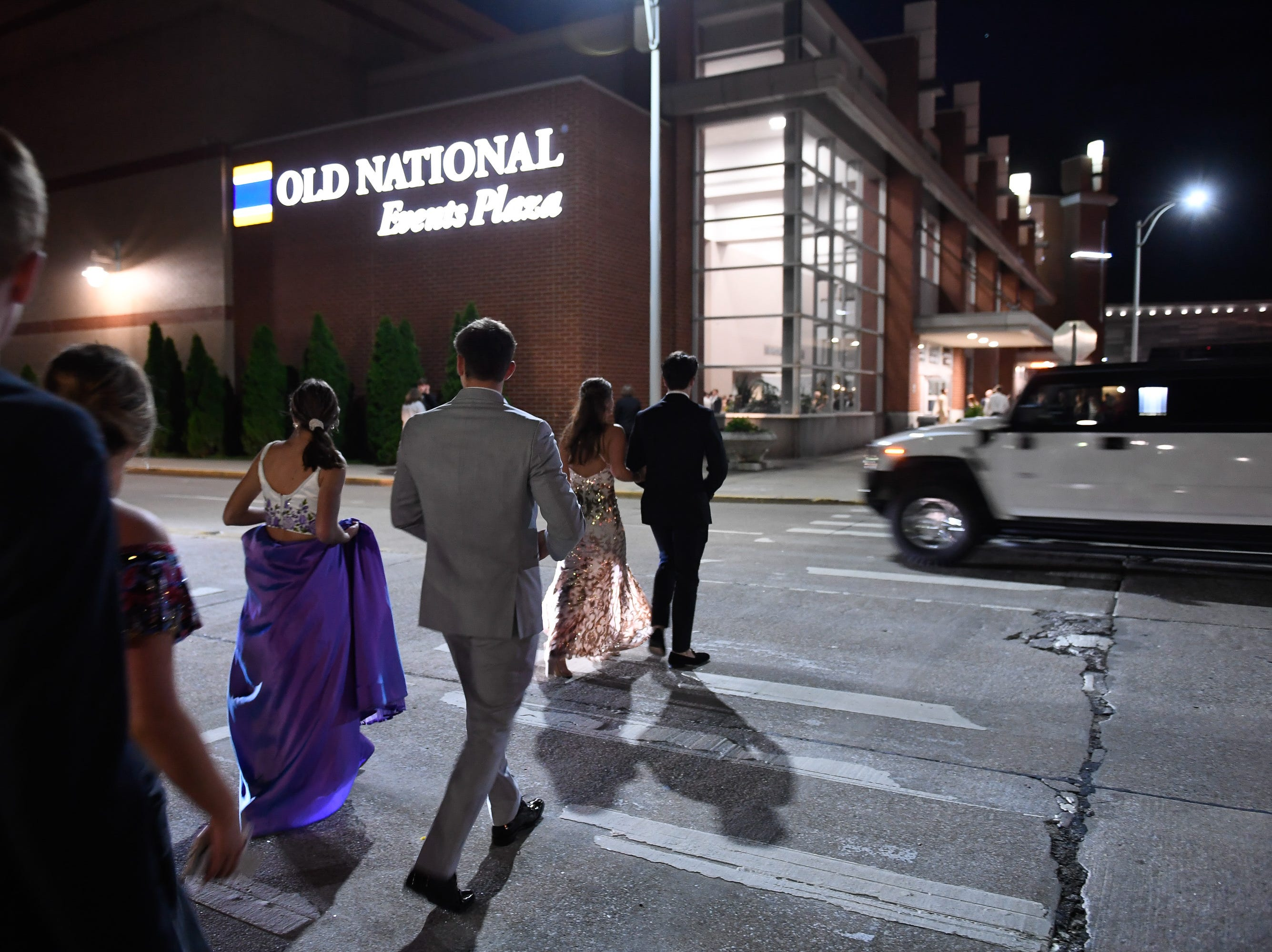 Elegantly dressed couples and limousines converge on the Old National Events Plaza for the Castle, Boonville and  Memorial high school proms Saturday, April 27, 2019.