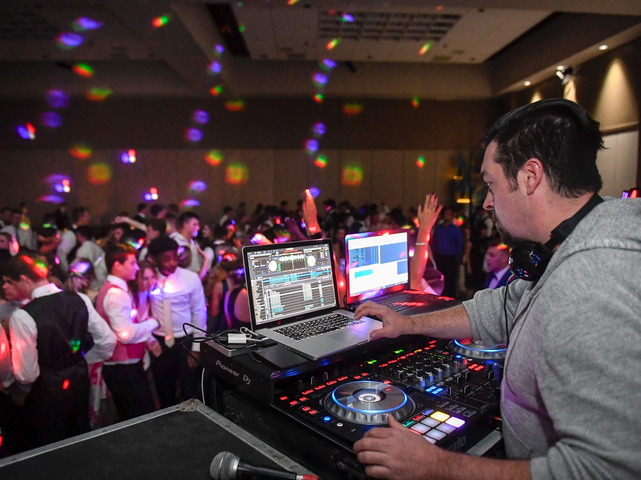 Spinning tunes, Allen Ball with Heart Breaker D.J. services keeps the party going at the Memorial High School prom, held at the Old National Events Center Plaza Saturday, April 27, 2019.