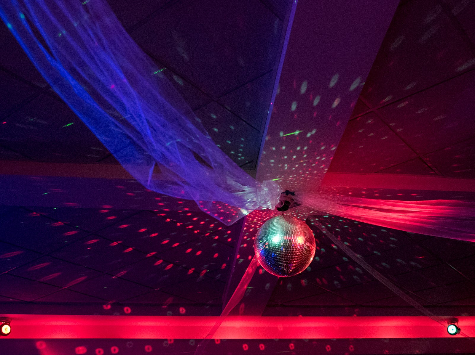A disco ball lights up the dance floor for Evansville Day School students during their prom held at the Hadi Shrine Banquet Hall in downtown Evansville, Ind., Saturday, April 27, 2019.