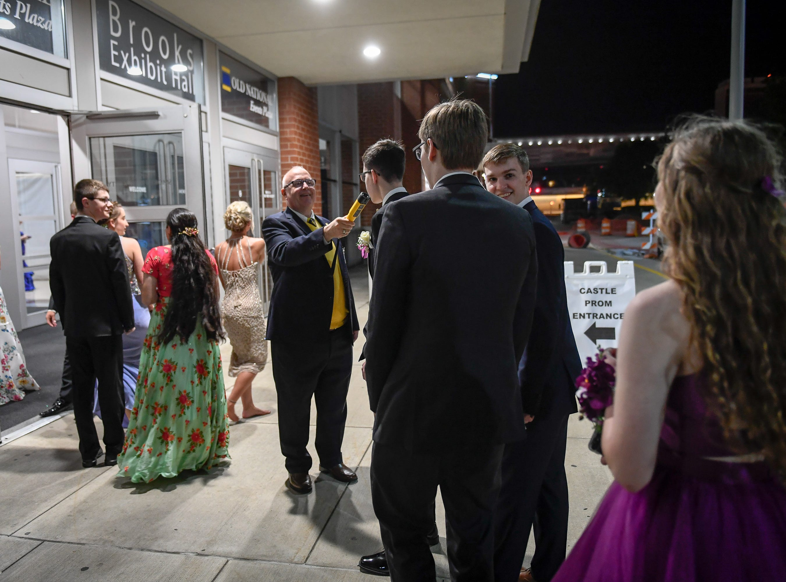 Richard Lance uses a breathalyzer to check couples entering the Castle High School prom, held at the Old National Events Center Plaza Saturday, April 27, 2019.