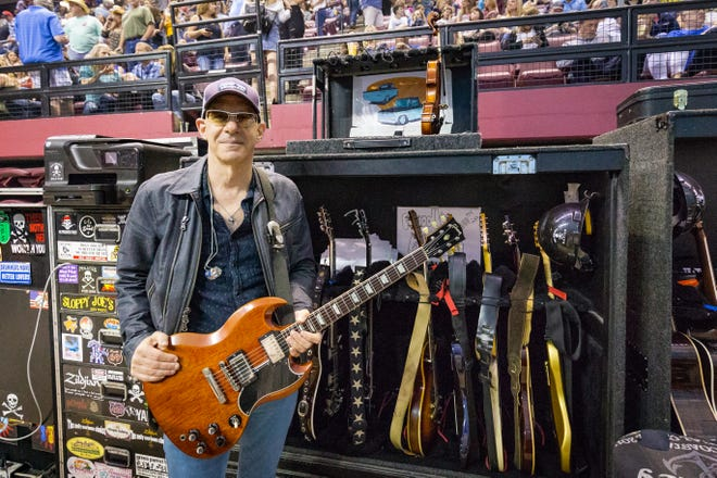 Kenny Greenberg, Nashville based music producer and professional guitarist, poses beside his case of guitars which travels with him as he tours with Kenny Chesney. Greenberg played along Chesney at the Donald L. Tucker Civic Center, Friday, April 26th, 2019.