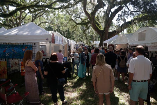 Art lovers enjoy the work of fine art painters, photographers, sculptors and other unique artists at the LeMoyne Chain of Parks Art Festival Saturday, April 27, 2019.