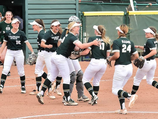 CSU softball players, including Bridgette Hutton (13) and Tara Shadowen (11), celebrate during a 4-3 win over San Diego State on April 28, 2019, at Ram Field. The Rams clinched their first Mountain West title since 2004 and first trip to the NCAA Regionals since 2003 on Saturday by beating Boise State 3-1 in Boise, Idaho.