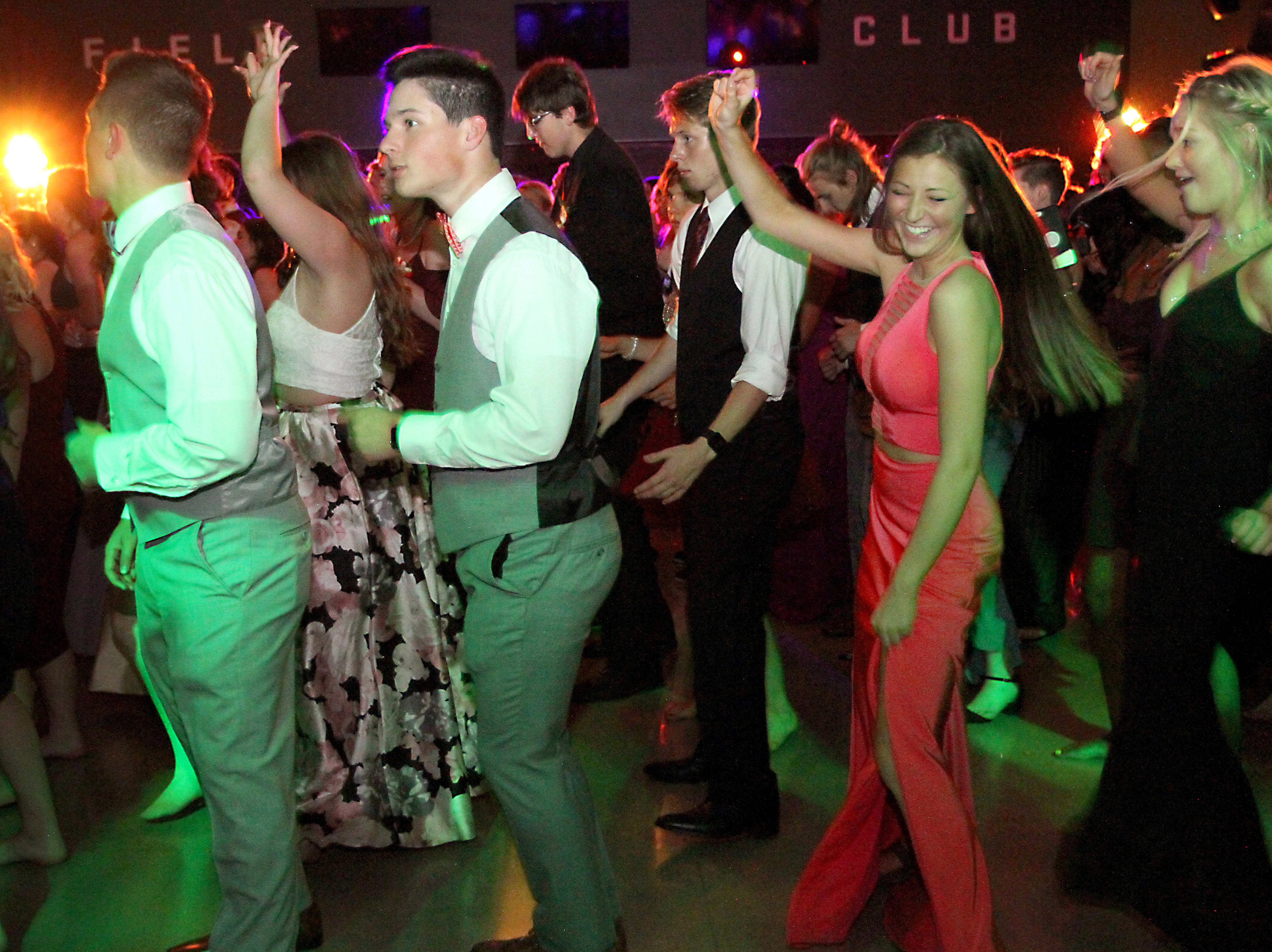 Joel Blocker / For the Coloradoan Fort Collins high School, from left, Diego Aragon, Aaron Van Metre, Zoe Struble and Amelia Welch, dance the night away during the Fort Collins High School prom held at Canvas stadium Saturday night.