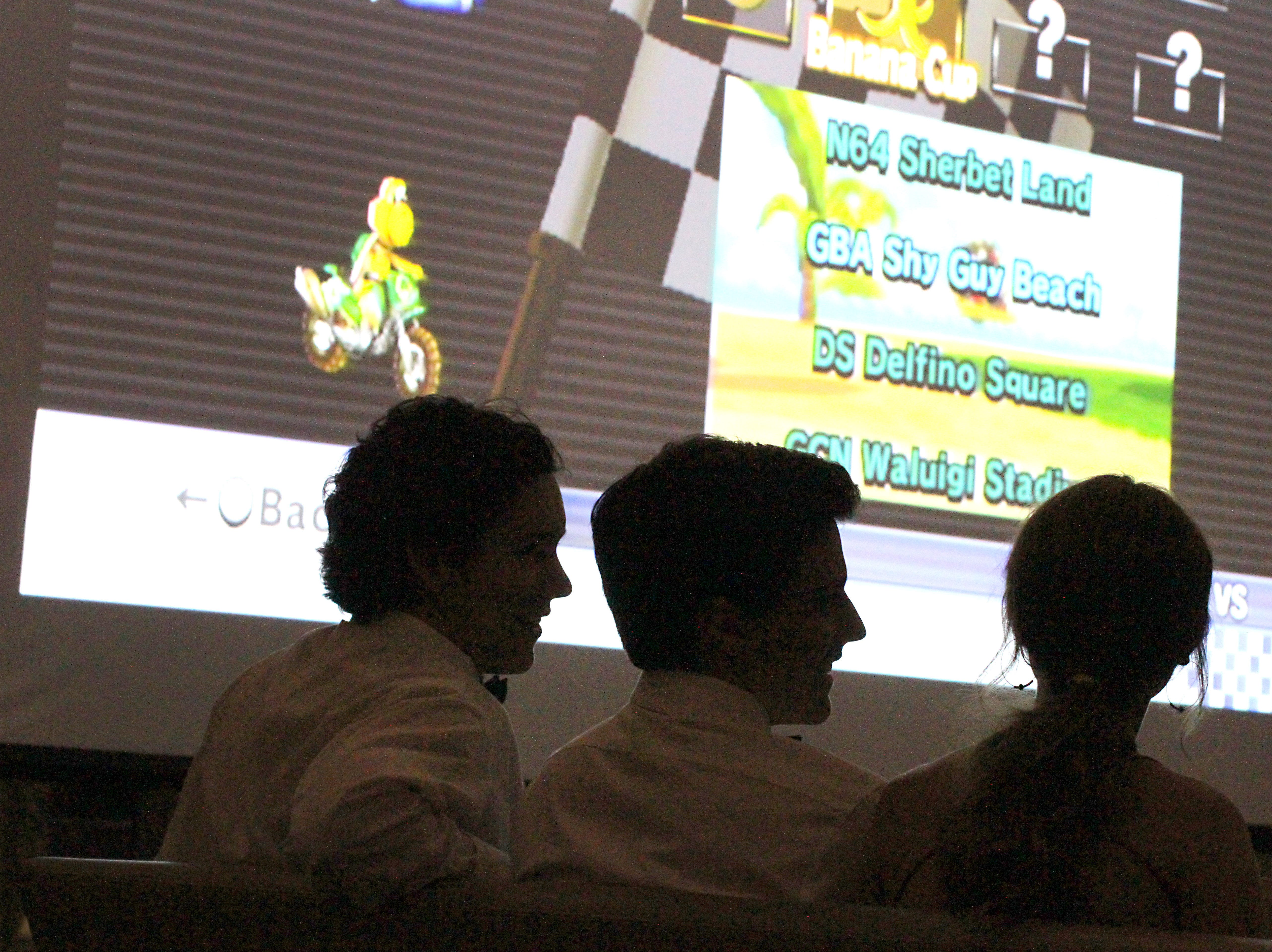 Joel Blocker / For the ColoradoanFort Collins High School seniors, from left, James Donahue, Will Lamperes and Savannah Sanford, take a break from dancing to play video games during the Fort Collins High School prom held at Canvas stadium Saturday night.