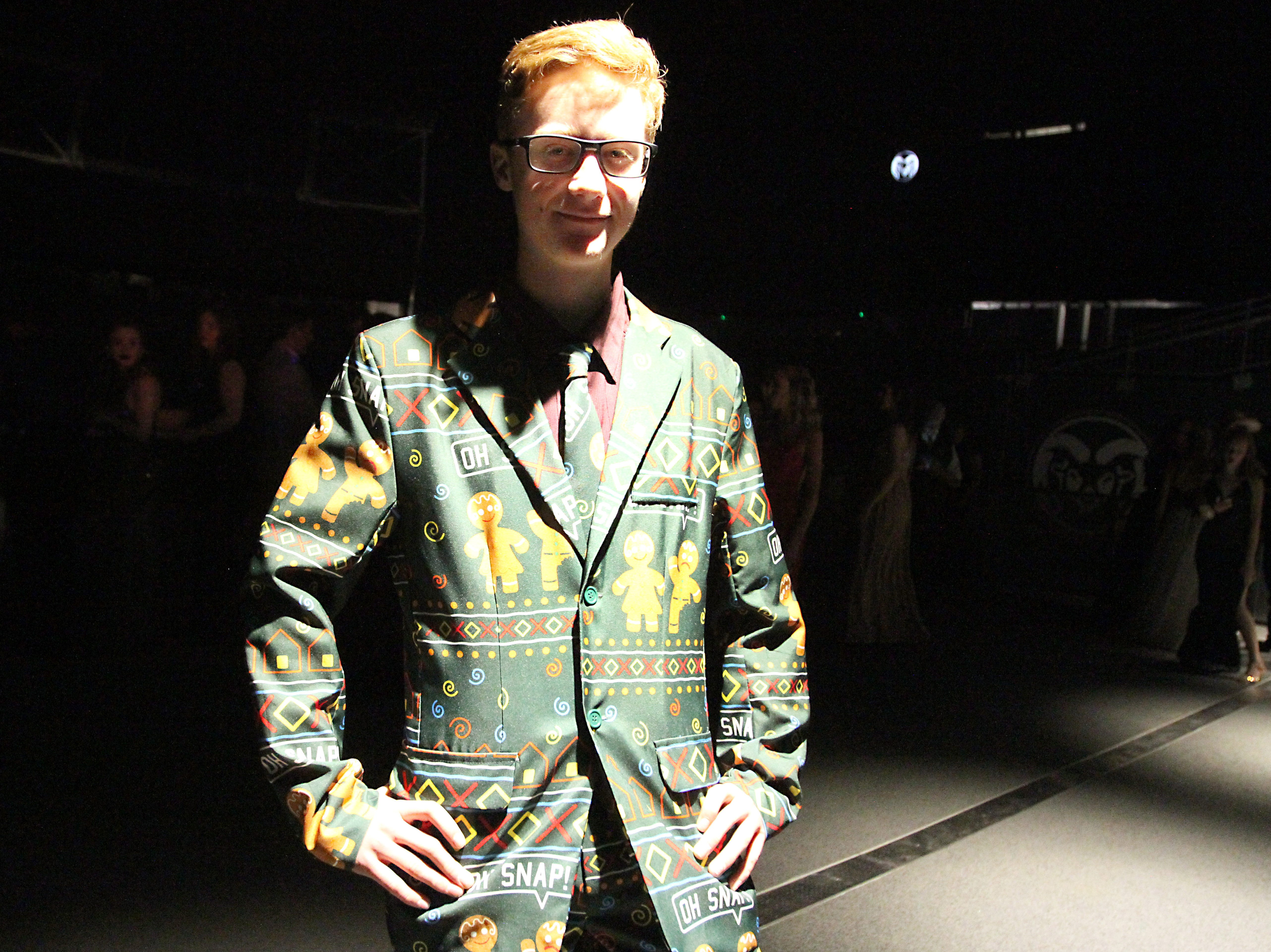 Joel Blocker / For the Coloradoan  Cody Robertson, a junior at Fort Collins High School, posses for a photo in his ginger bread suit during the Fort Collins High School prom held at Canvas stadium Saturday night.