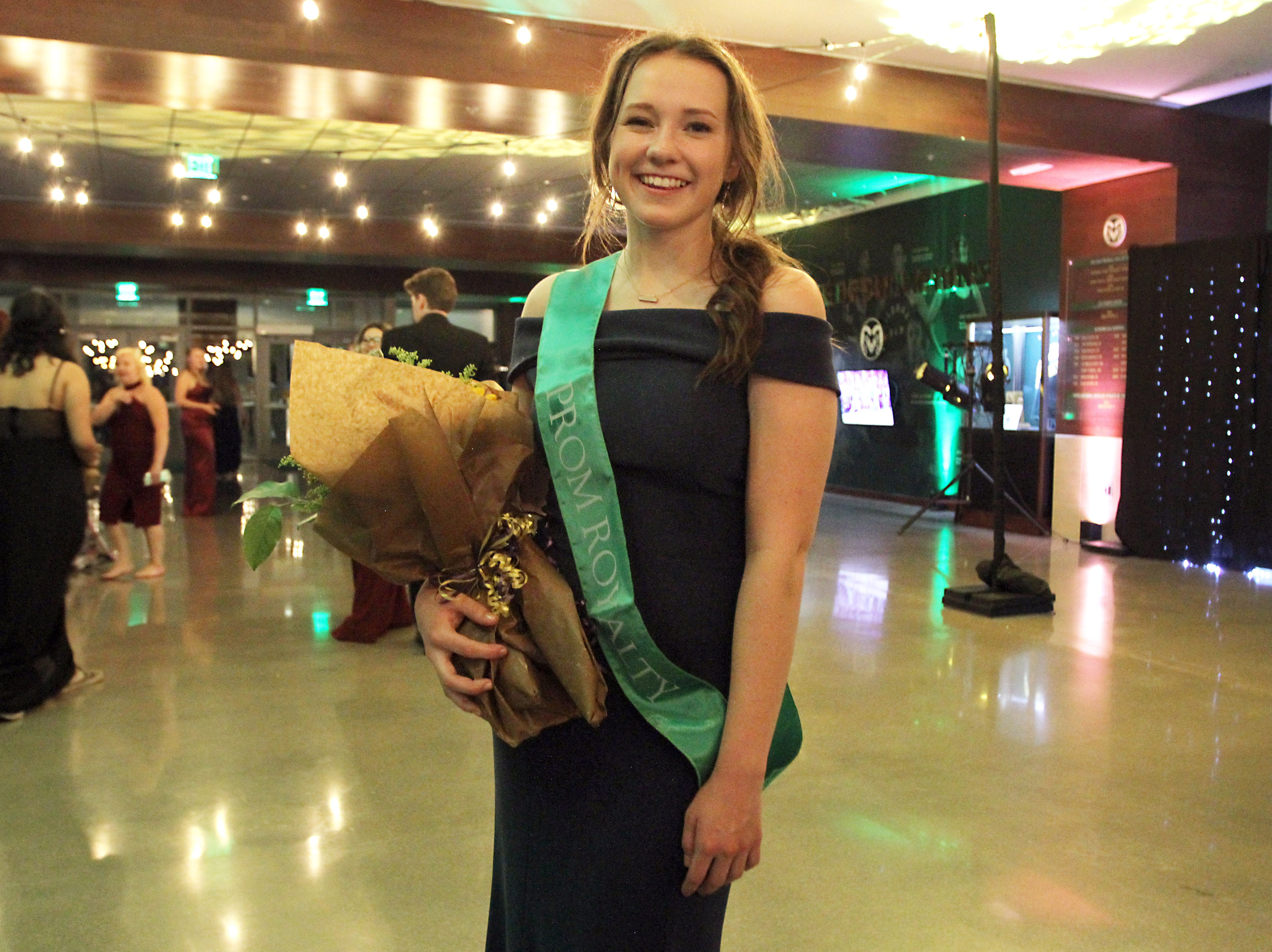 Joel Blocker / For the Coloradoan Carly Rockwell, a senior at Fort Collins High School, posses for a photo after being named to prom royalty, during the Fort Collins High School prom held at Canvas stadium Saturday night.