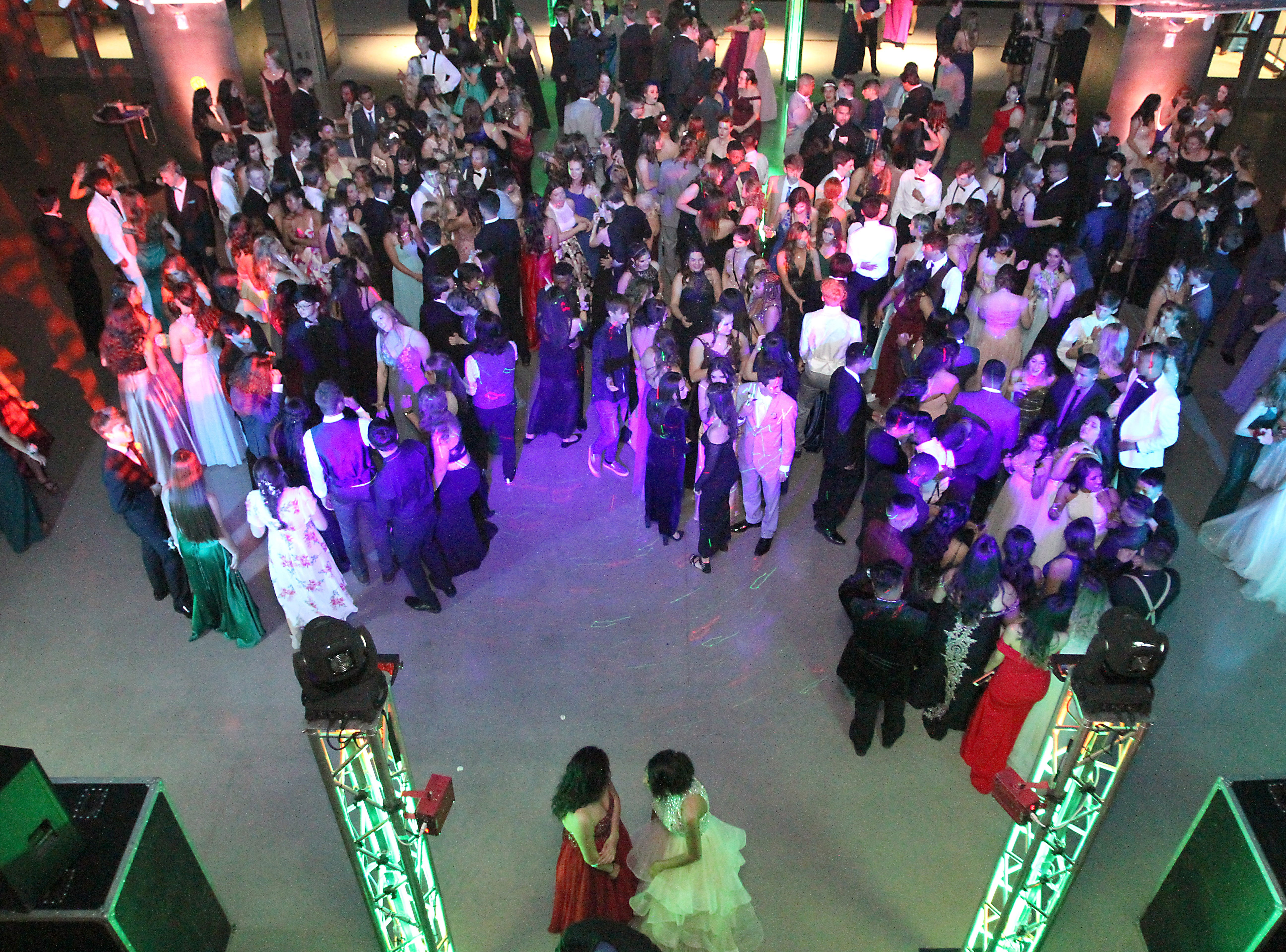 Joel Blocker / For the ColoradoanFort Collins High School students pack the dance floor during their school prom held at Canvas stadium Saturday night.