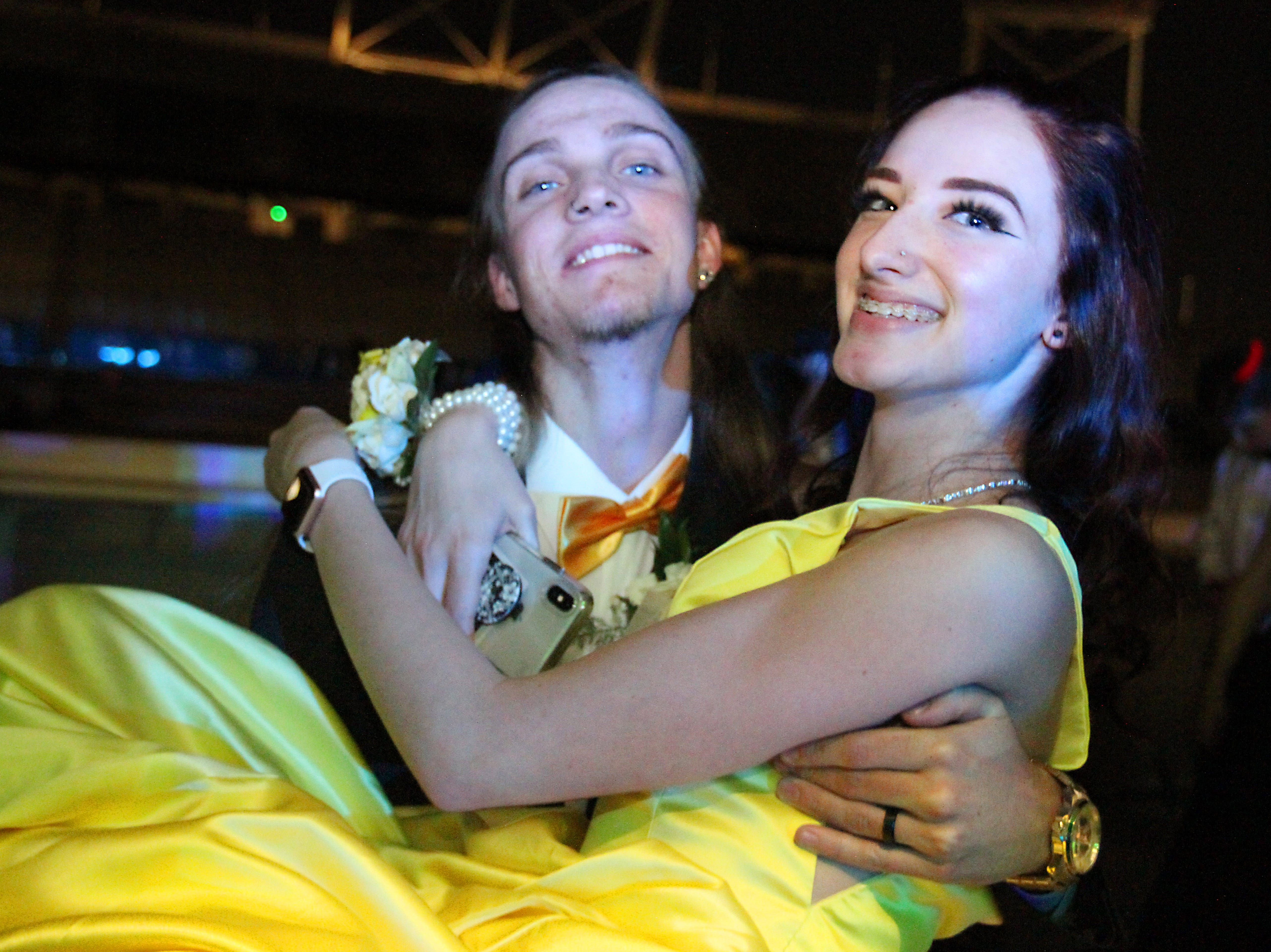 Joel Blocker / For the Coloradoan Fort Collins High School juniors, from left, Brodi Henkelman and Ashlynn Bledsoe take a moment for photo during the LambkinsÕ prom held at Canvas stadium Saturday night.