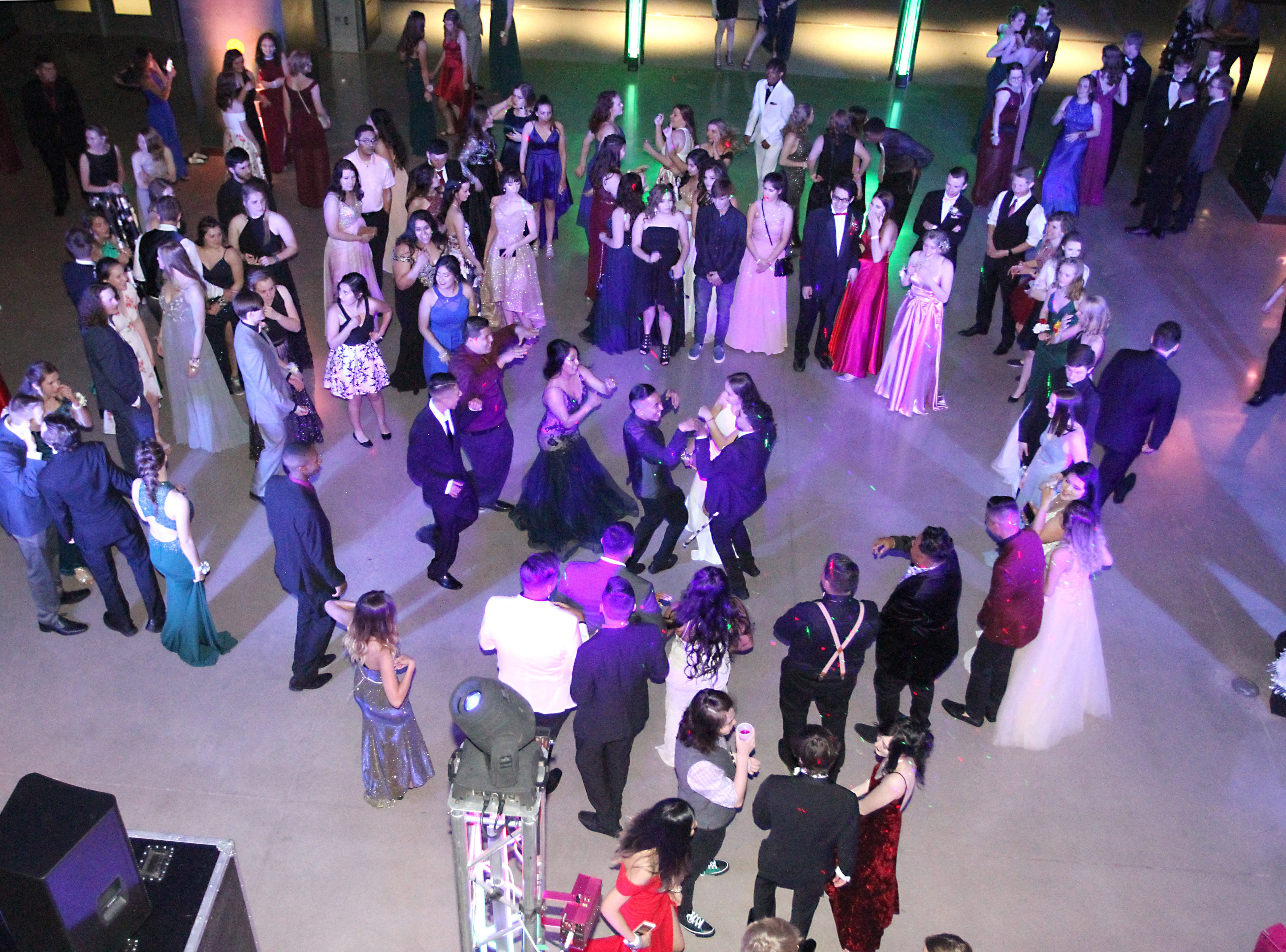 Joel Blocker / For the ColoradoanFort Collins High School students dance the night away during their school prom held at Canvas stadium Saturday night.