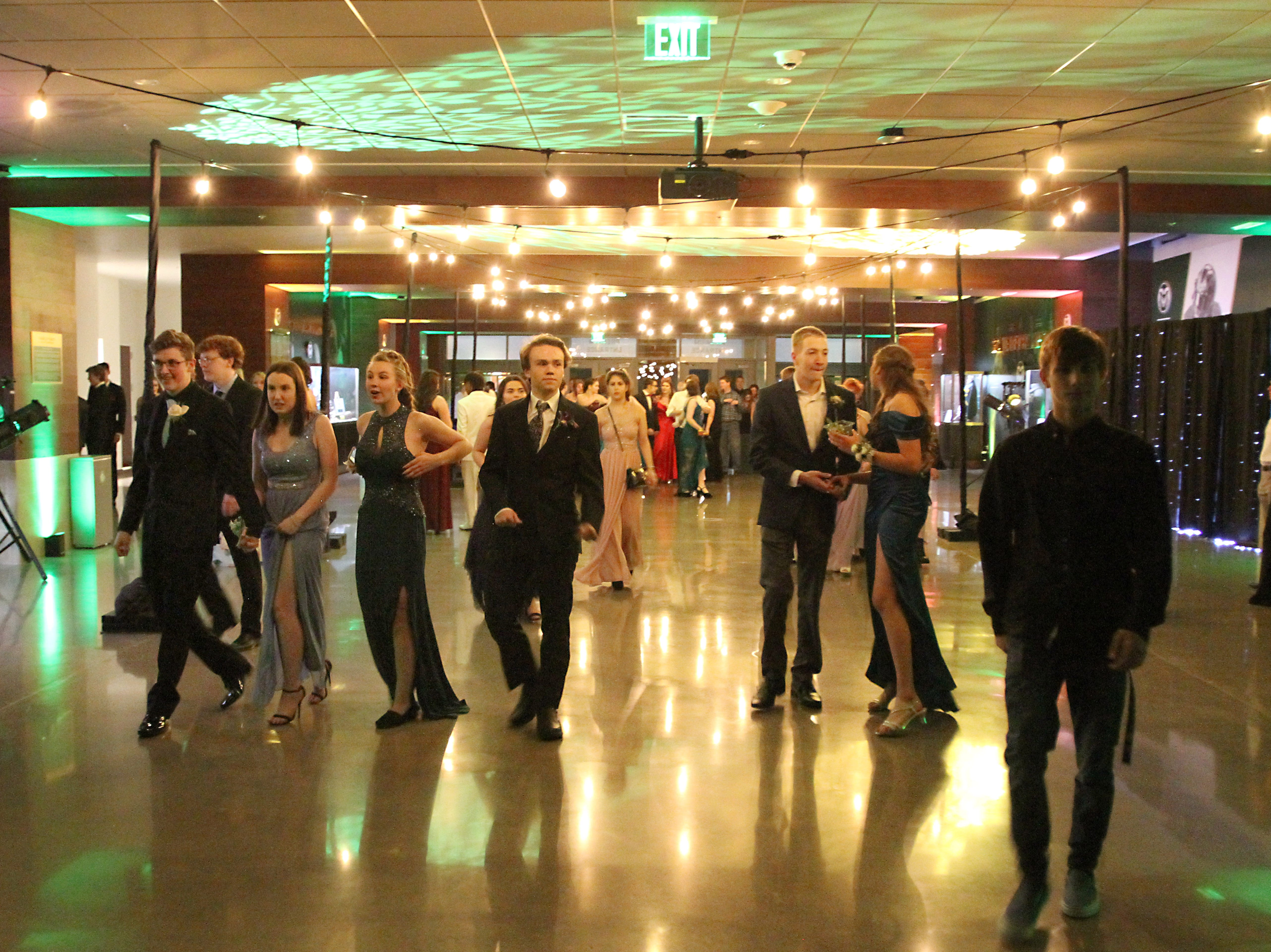 Joel Blocker / For the ColoradoanFort Collins High School students fill the breezeway at Canvas Stadium as they begin to show up for the schoolÕs prom Saturday evening.