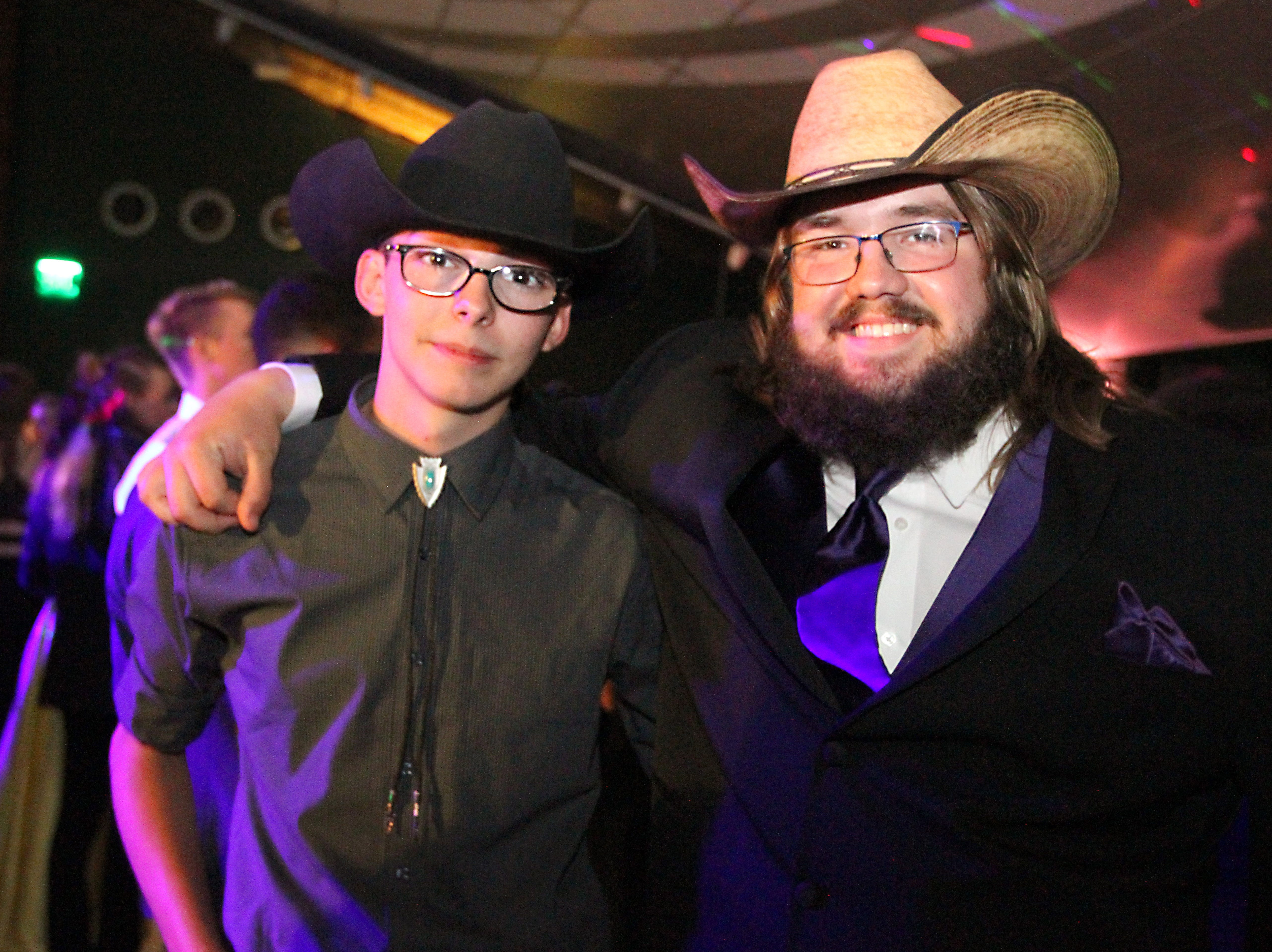 Joel Blocker / For the Coloradoan Fort Collins high School students, from left, Joseph Schippers and Tucker Leadbetter, take a moment to pose for a photo during the Fort Collins High School prom held at Canvas stadium Saturday night.