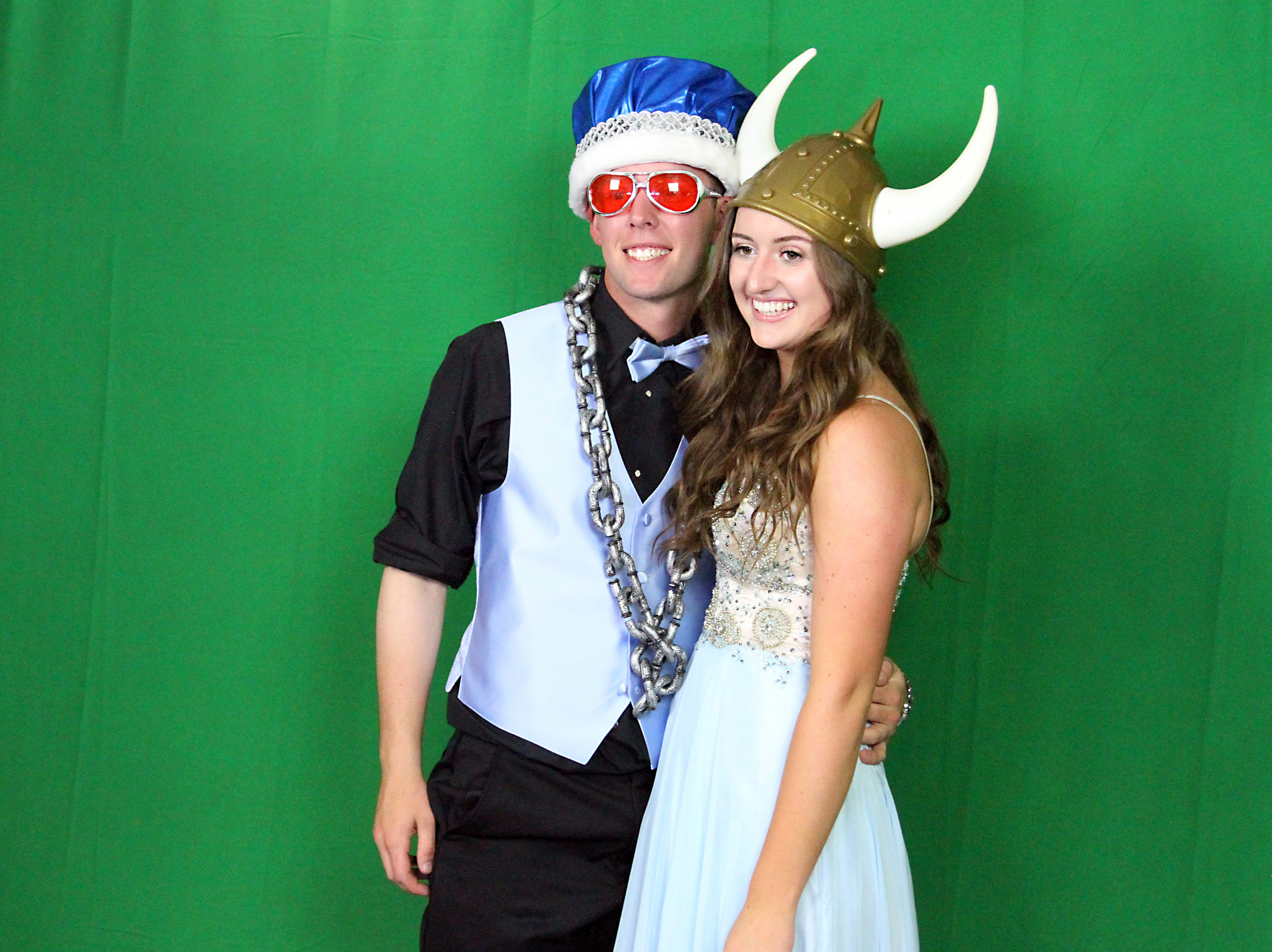 Joel Blocker / For the ColoradoanFort Collins High School seniors, Caleb Brlecic and Claire Freeman, pose in a front of a green screen while getting their pictures taken from a photo booth during the Fort Collins High School prom held at Canvas stadium Saturday night.