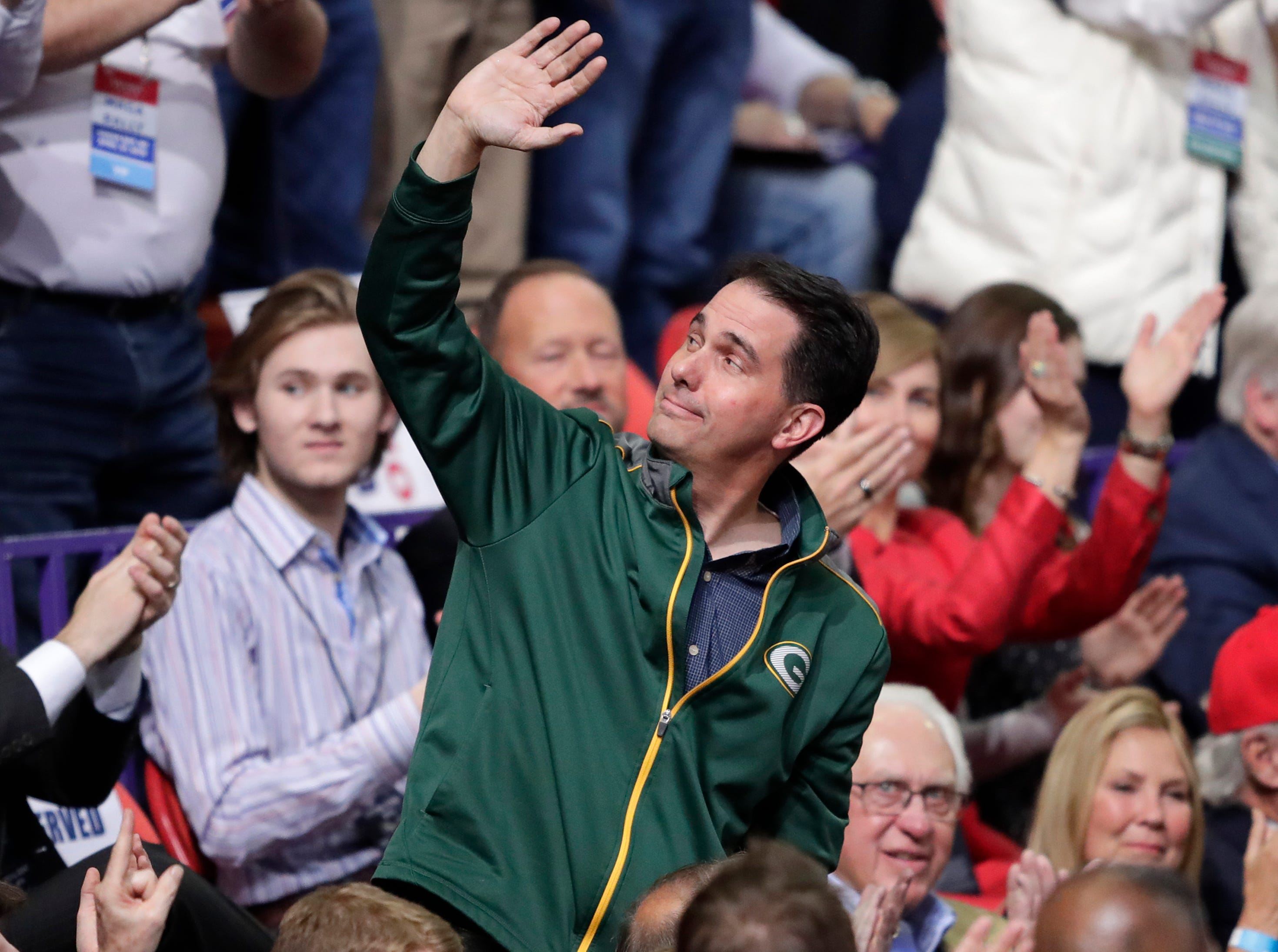 Former Wisconsin Governor Scott Walker waves to the crowd after being mentioned by President Donald J. Trump during a Make America Great Again Rally on Saturday, April 27, 2019, at the Resch Center in Green Bay, Wis.
