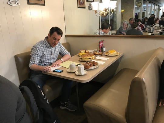 """Fox & Friends"" correspondent Todd Piro preps for his ""Breakfast with Friends"" segment Sunday morning at The Pancake Place."