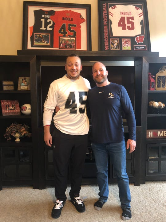 Alec Ingold, left, with Bay Port football coach Gary Westerman. Ingold, wearing an Oakland Raiders jersey, agreed to an undrafted free agent deal with the Raiders.