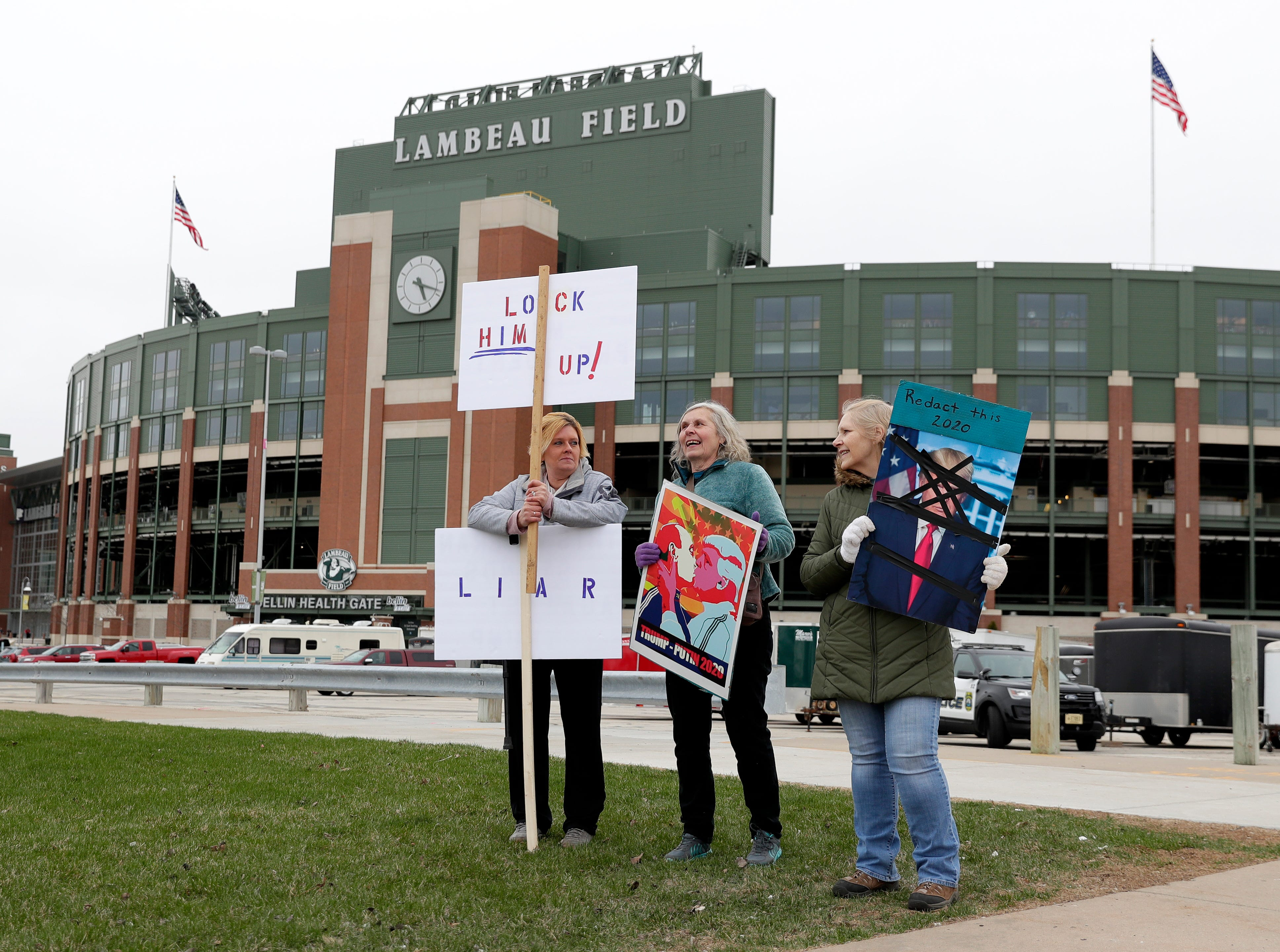 About 50 protesters stood at the corner of Ridge Road and Lombardi Avenue in Green Bay, Wis. before President Donald Trump's rally on April 27, 2019 at the Resch Center.