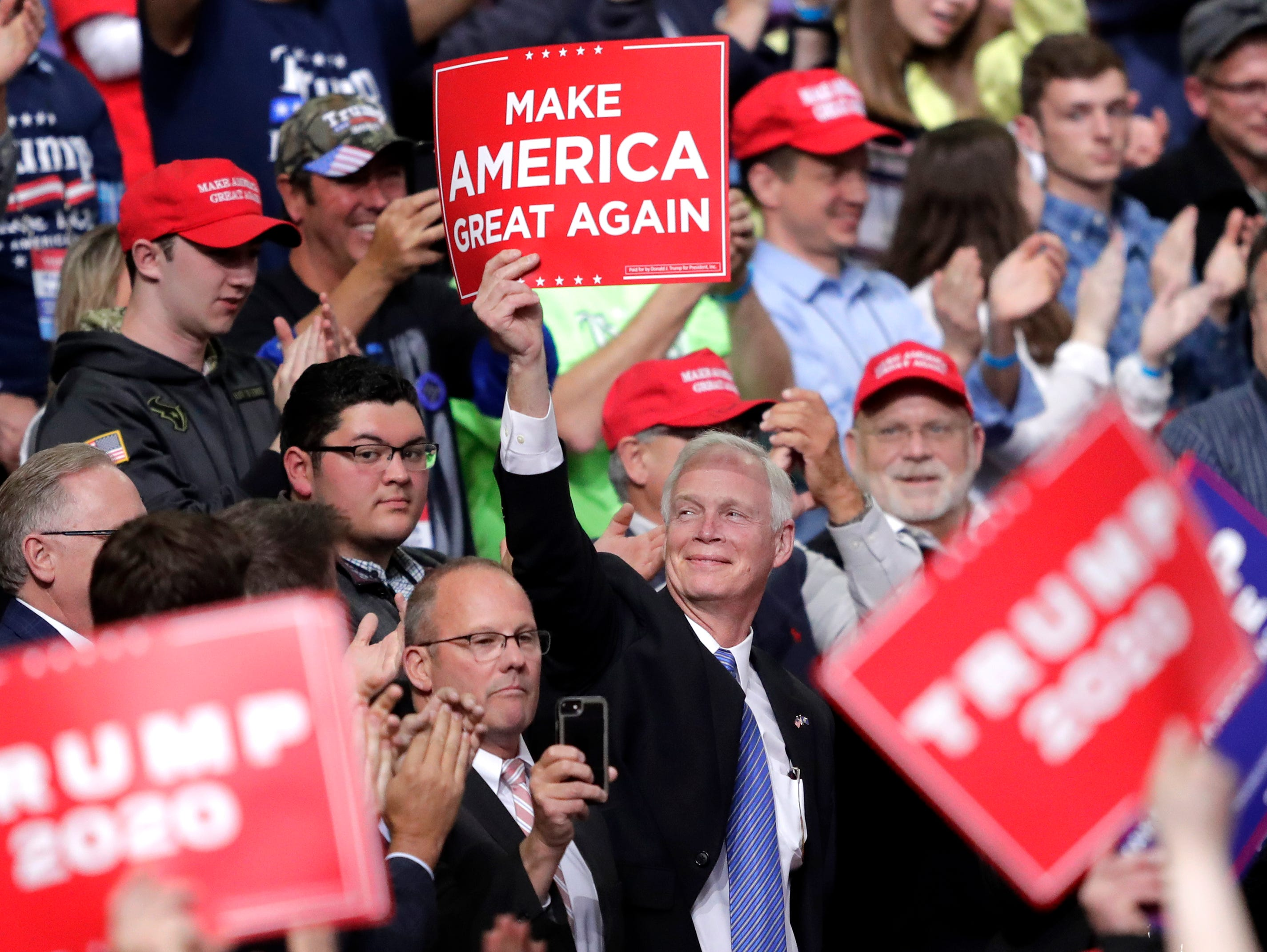 U.S. Senator Ron Johnson cheers as President Donald J. Trump speaks during a Make America Great Again Rally on Saturday, April 27, 2019, at the Resch Center in Green Bay, Wis.