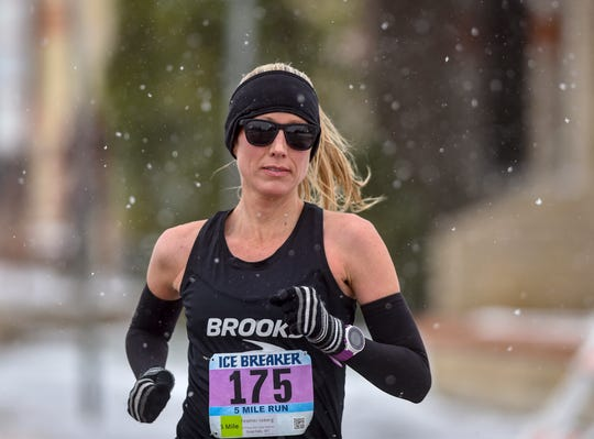 Heather Lieberg of Helena was the first place female finisher in the 5-mile run during the 40th annual Ice Breaker Road Race on Sunday afternoon.