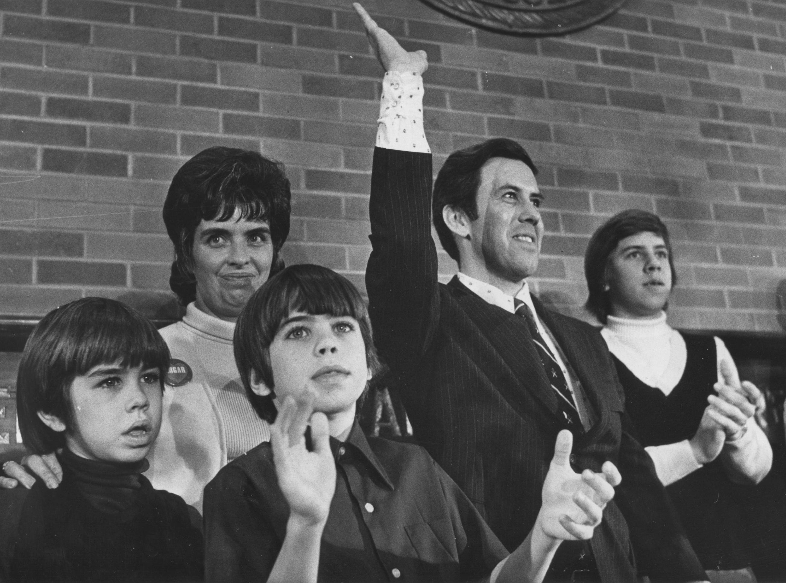 Richmond, Ind. -- Indianapolis Mayor Richard Lugar waves to persons attending the Wayne-Union Lincoln Day Dinner. From left are son David, 9. Mrs. Lugar, and sons John, 10; Mark, 15, and Robert 13. (2/15/1974)