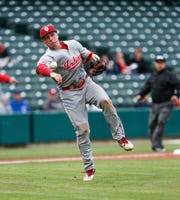 FILE -- The Indiana University Hoosiers infielder Justin Walker (10), send the ball to first base during a game between the Indiana University Hoosiers and Ball State Cardinals, at Victory Field in Indianapolis on Tuesday, April 23, 2019.