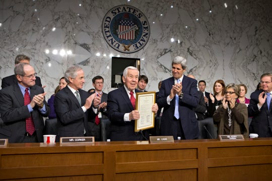 Sen. Richard Lugar, center, the ranking member of the Senate Foreign Relations Committee, is applauded for his service by fellow committee members at his last hearing before leaving the Senate, on Capitol Hill in Washington, Thursday, Dec. 20, 2012. From left to right are Sen. James Risch, R-Idaho, Sen. Bob Corker, R-Tenn., Sen. Richard Lugar, R-Ind., Sen. John Kerry, D-Mass., Sen. Barbara Boxer, D-Calif., and Sen. Robert Menendez, D-N.J. (AP Photo/J. Scott Applewhite)