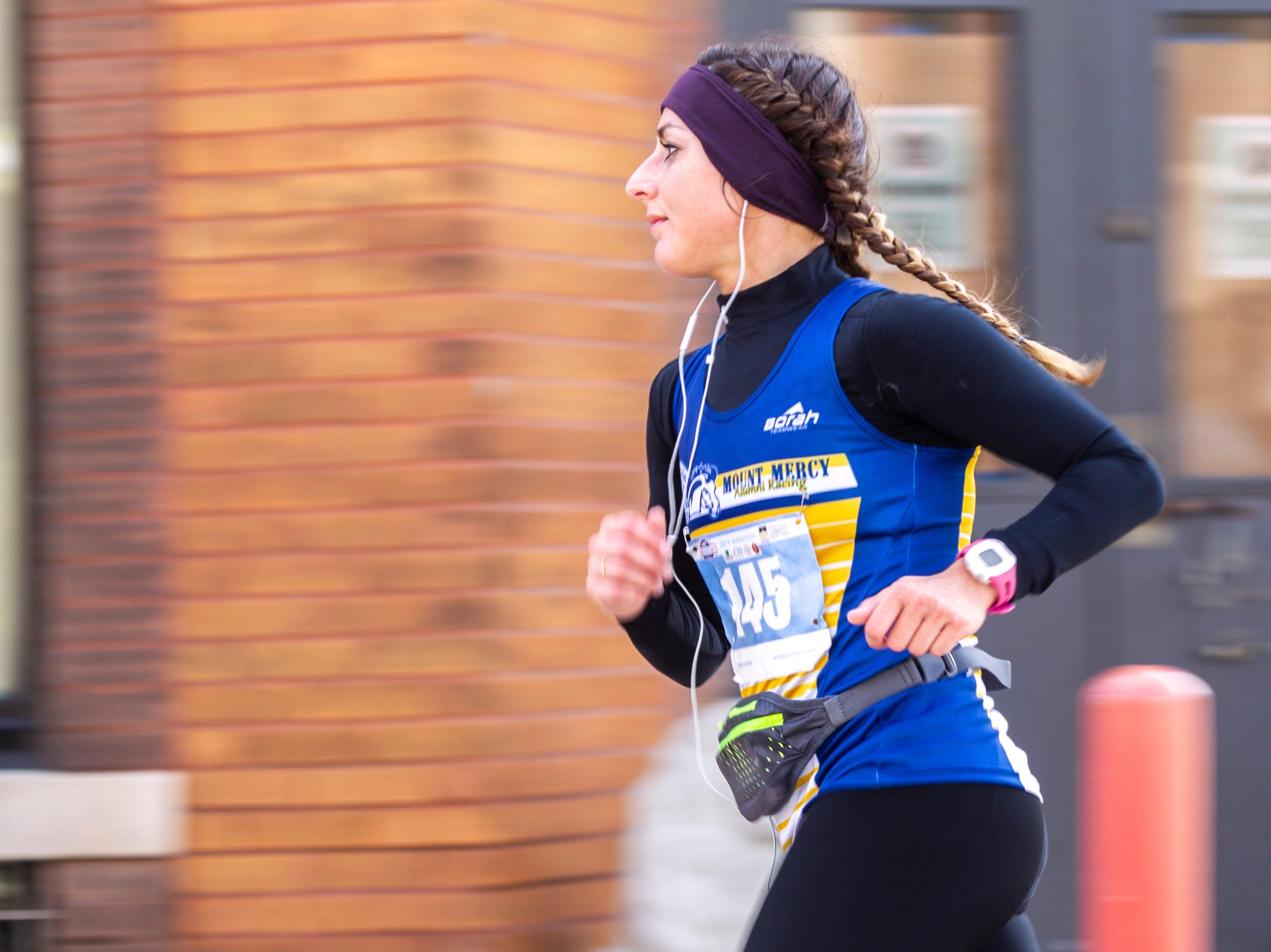 Katie Hoffert makes the final turn towards the finish line during the second annual Run CRANDIC marathon, Sunday, April 28, 2019, along 16th Avenue SE in Cedar Rapids, Iowa.