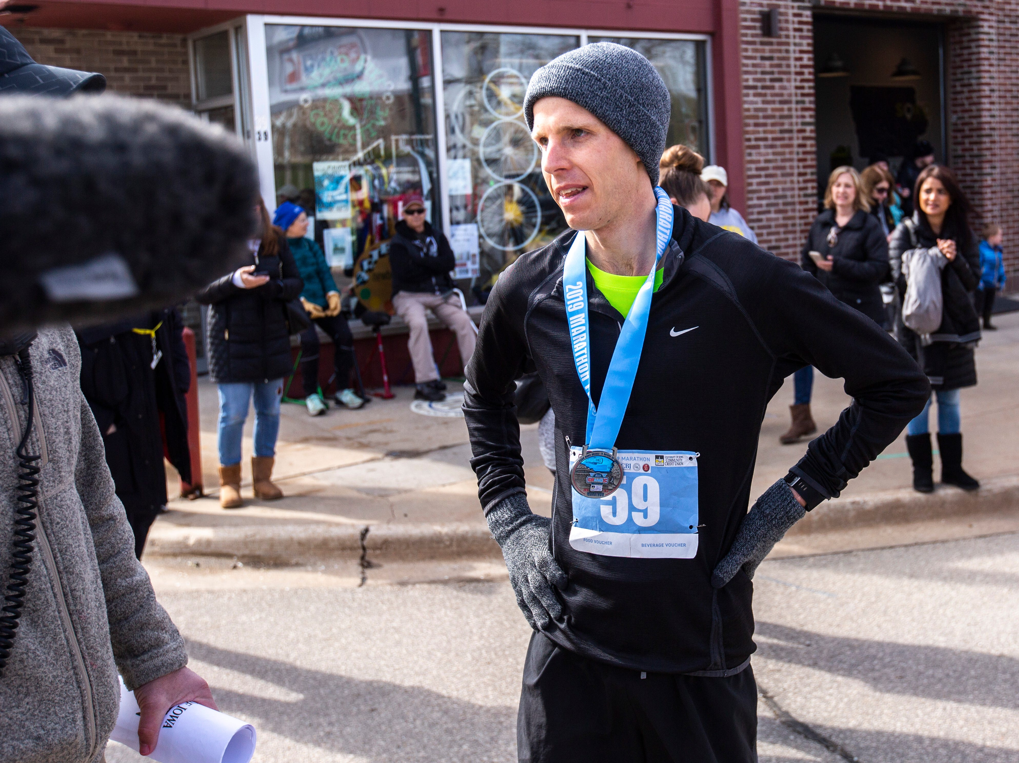 Tyler Culver of Cedar Rapids celebrates after being the first man to finish during the second annual Run CRANDIC marathon, Sunday, April 28, 2019, along 16th Avenue SE in Cedar Rapids, Iowa. Culver finished with a time of 2:50:02.