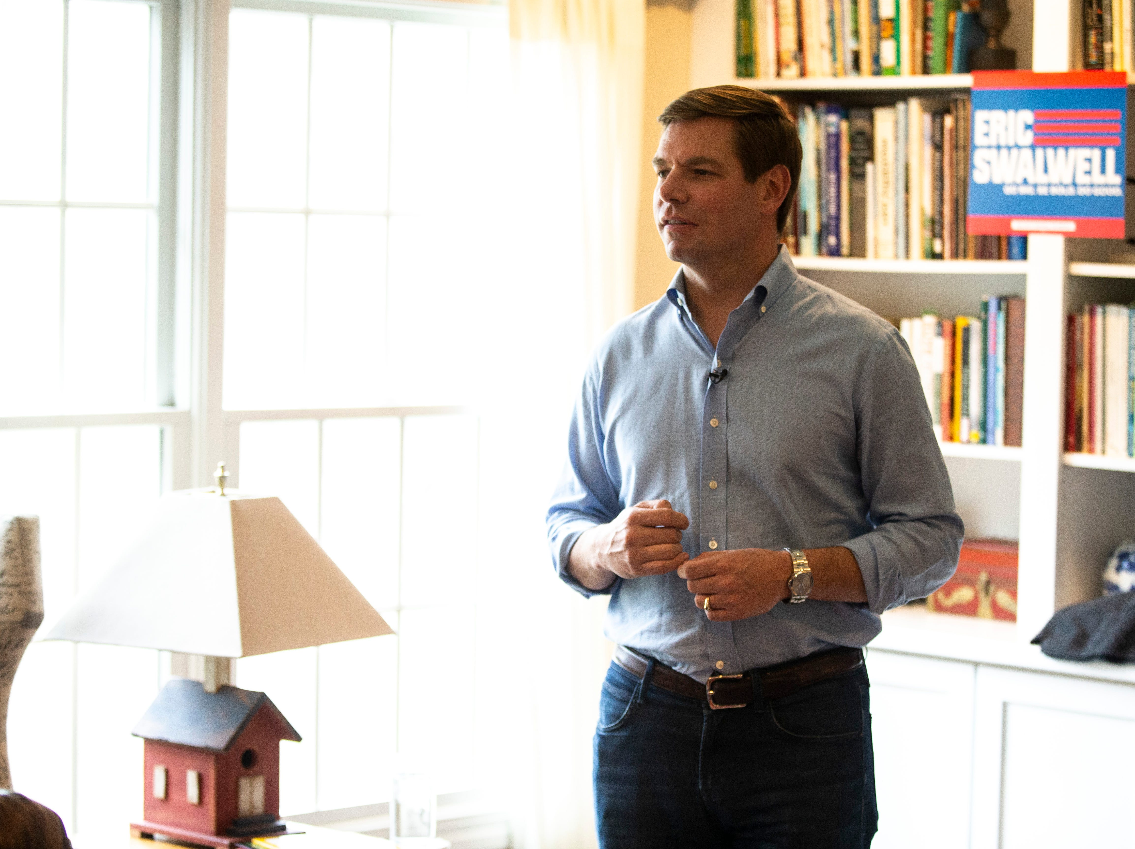 """U.S. Rep. Eric Swalwell, D-Calif., speaks to a group at a house party hosted by the """"Potluck Insurgency"""" group, Sunday, April 28, 2019, at a home in North Liberty, Iowa."""