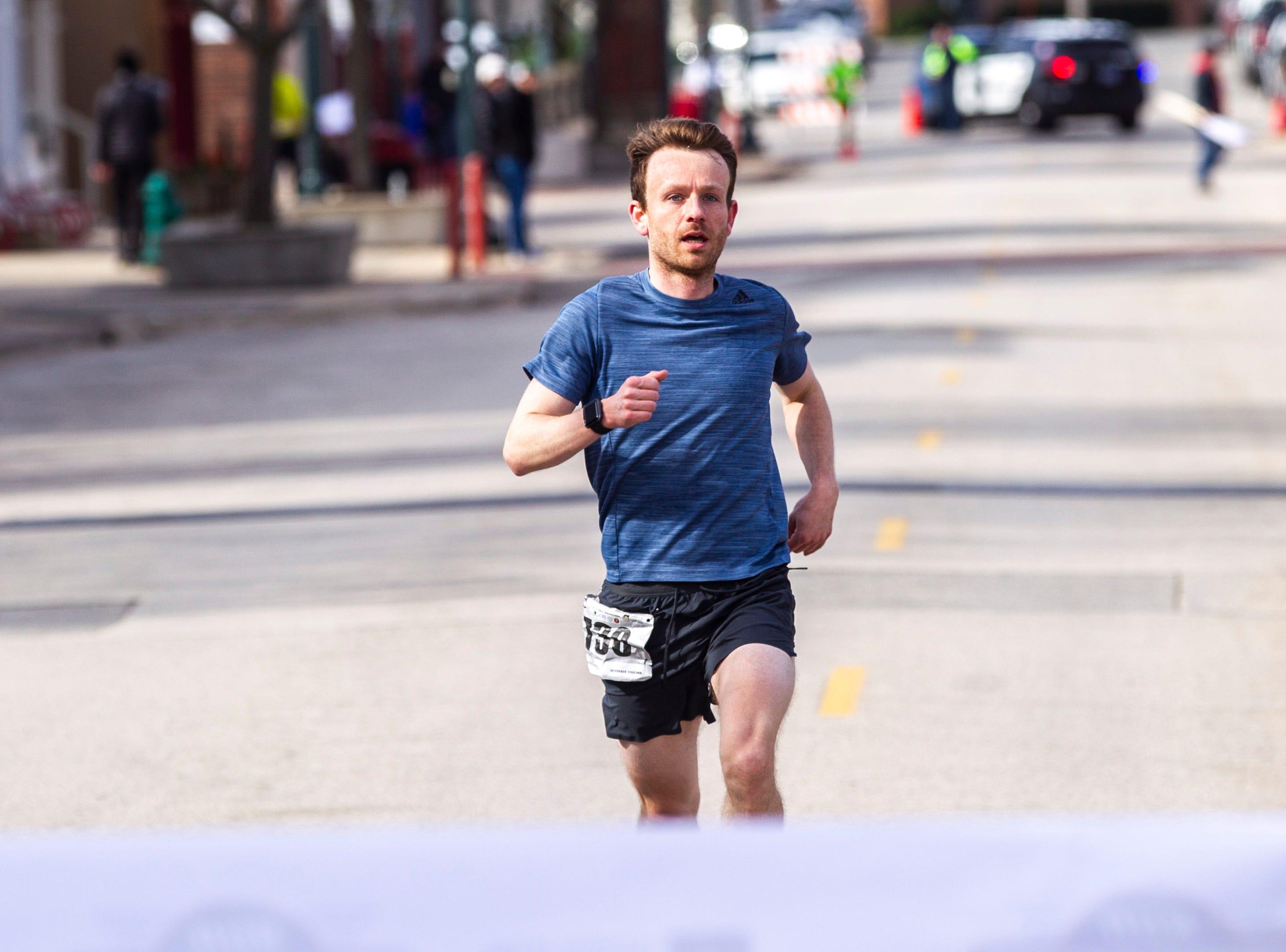 Chase Atkinson nears the finish line for the half marathon during the second annual Run CRANDIC marathon, Sunday, April 28, 2019, along 16th Avenue SE in Cedar Rapids, Iowa.