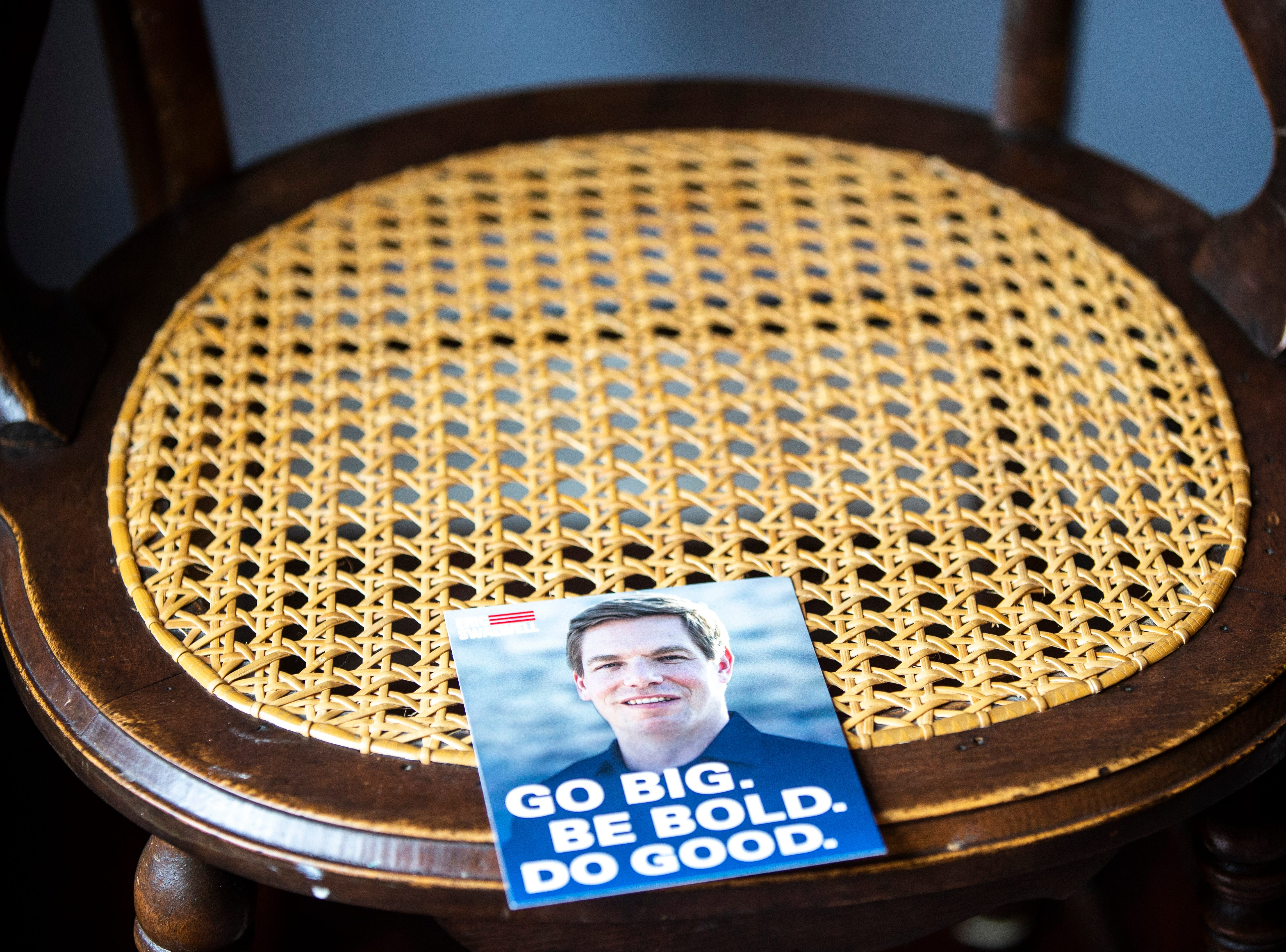"""A informational flier for U.S. Rep. Eric Swalwell, D-Calif., sits on a chair at a house party hosted by the """"Potluck Insurgency"""" group, Sunday, April 28, 2019, at a home in North Liberty, Iowa."""