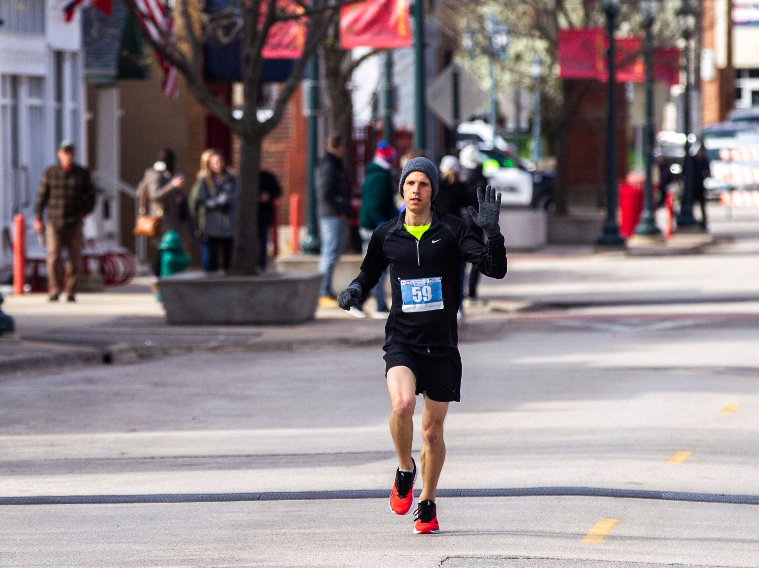 Tyler Culver of Cedar Rapids runs towards the finish line to be the first man to finish during the second annual Run CRANDIC marathon, Sunday, April 28, 2019, along 16th Avenue SE in Cedar Rapids, Iowa. Culver finished with a time of 2:50:02.