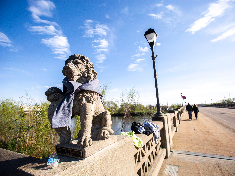 A lion statue has a sweatshirt wrapped around it during the second annual Run CRANDIC marathon, Sunday, April 28, 2019, along 16th Avenue SE in Cedar Rapids, Iowa.