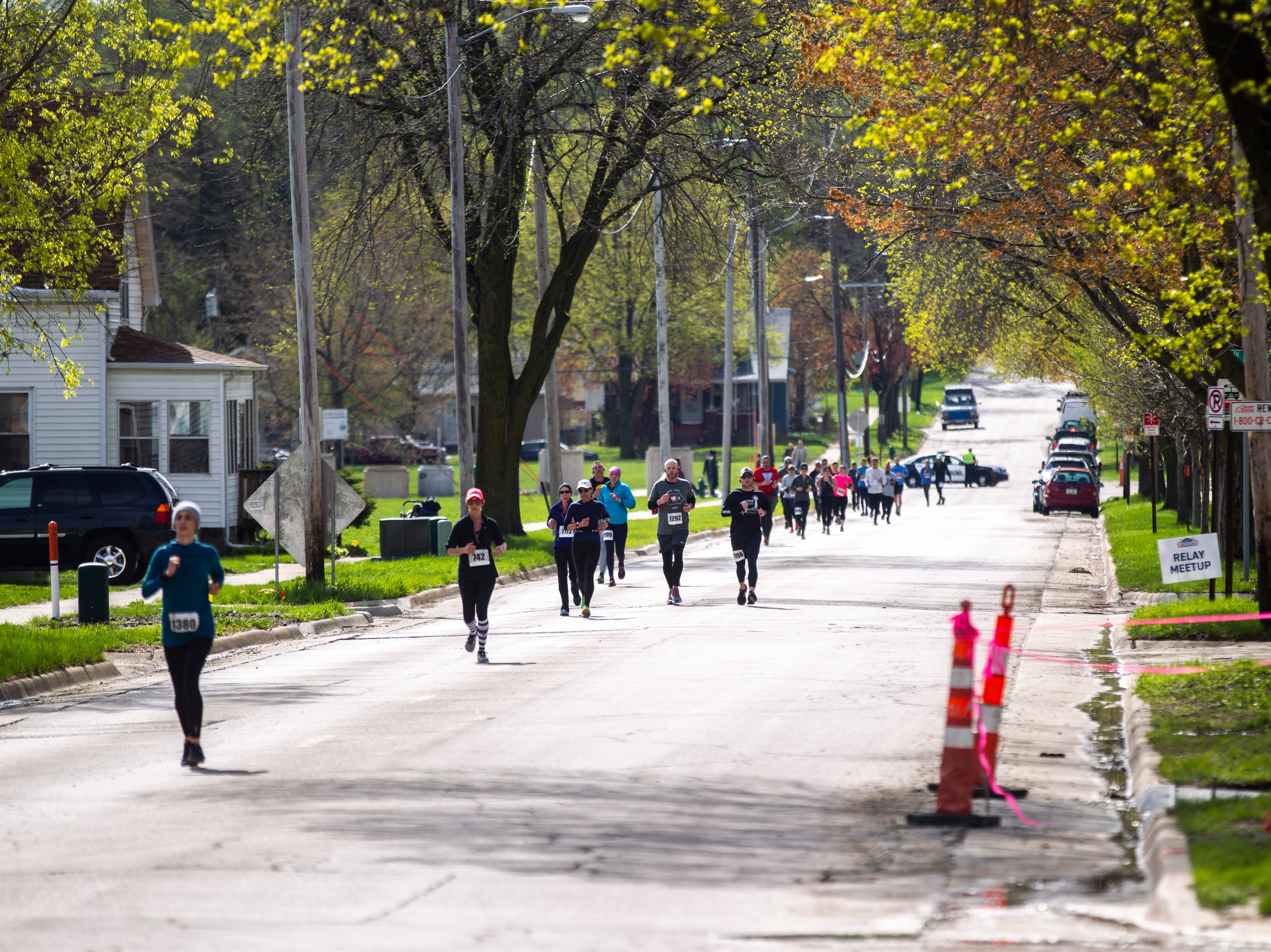 Runners make their way through the final stretch of the route past the 26 mile marker during the second annual Run CRANDIC marathon, Sunday, April 28, 2019, along C Street SW in Cedar Rapids, Iowa.