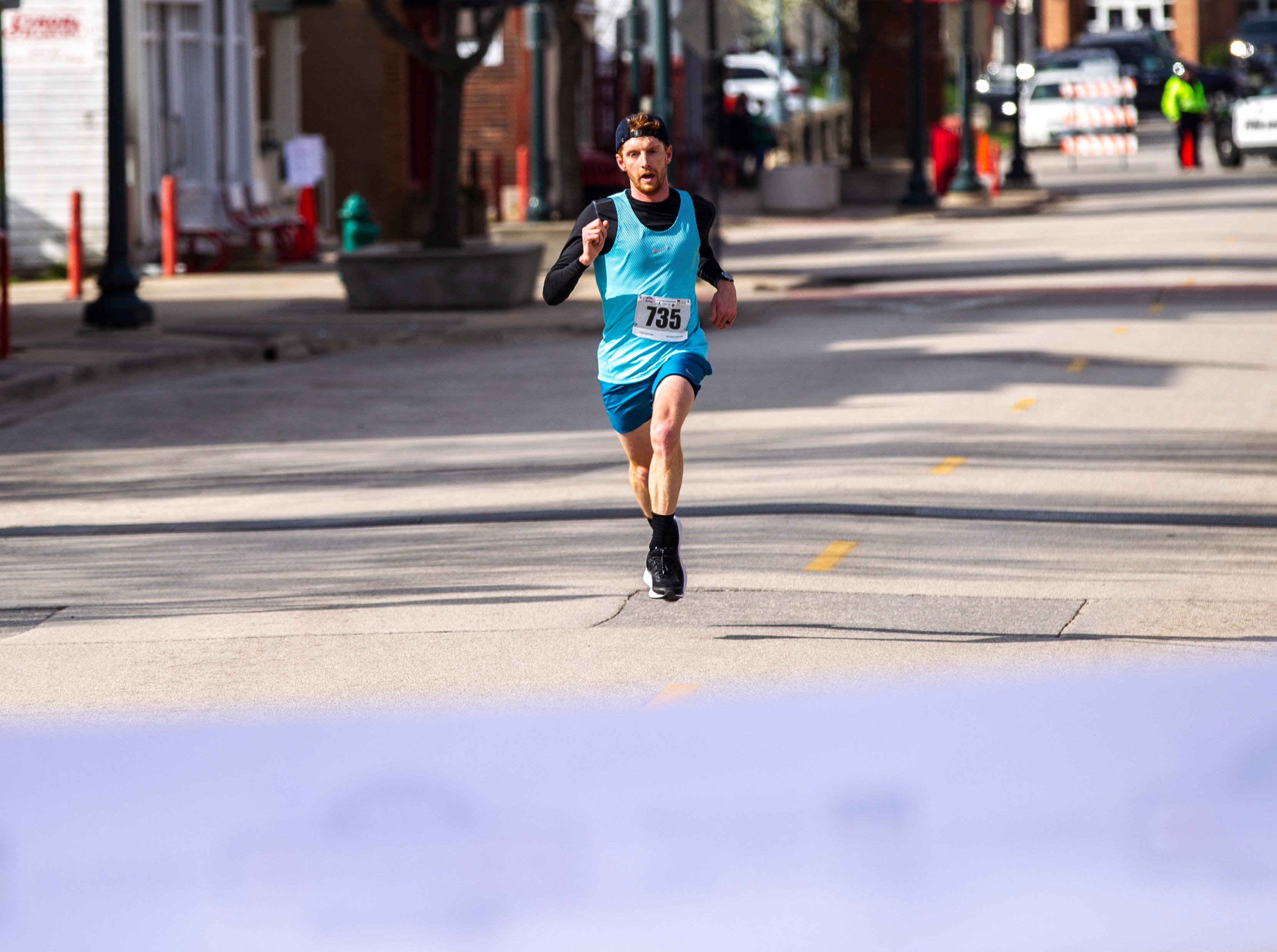 Erik Bandy nears the finish line for the half marathon during the second annual Run CRANDIC marathon, Sunday, April 28, 2019, along 16th Avenue SE in Cedar Rapids, Iowa. Bandy finished with a time of 1:12:13.