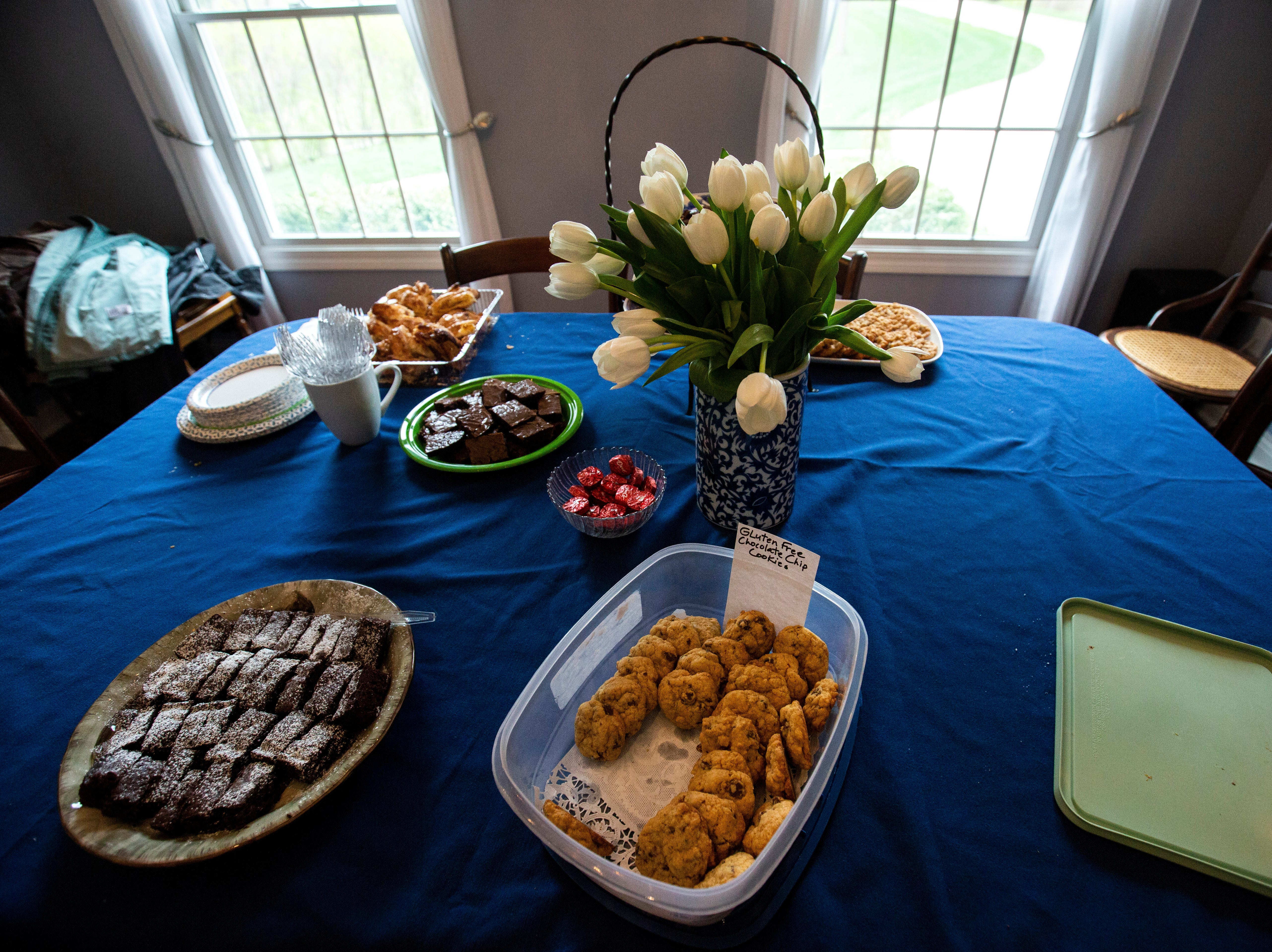 """A table of desserts is pictured while U.S. Rep. Eric Swalwell, D-Calif., speaks to a group at a house party hosted by the """"Potluck Insurgency"""" group, Sunday, April 28, 2019, at a home in North Liberty, Iowa."""