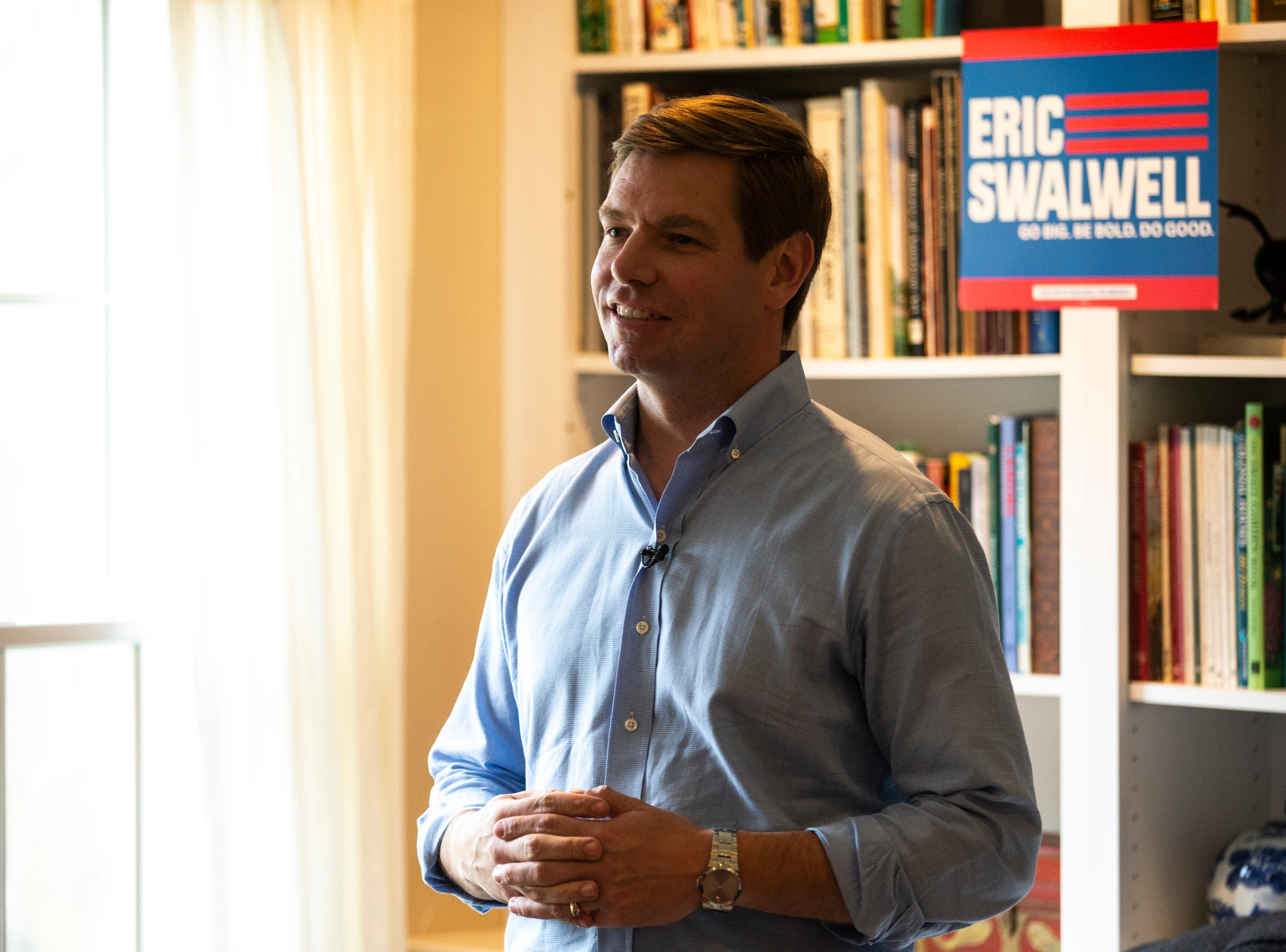 """U.S. Rep. Eric Swalwell, D-Calif., smiles while speaking to a group at a house party hosted by the """"Potluck Insurgency"""" group, Sunday, April 28, 2019, at a home in North Liberty, Iowa."""