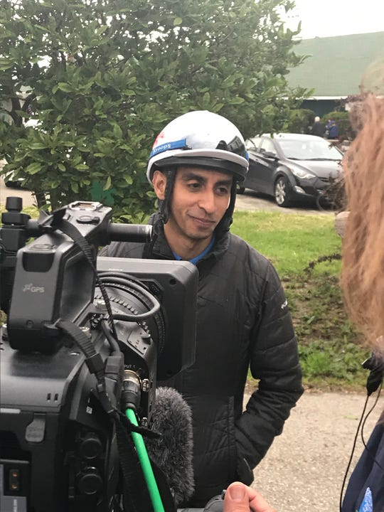 Win Win Win's jockey Julian Pimentel speaks to a camera crew on the backside of Churchill Downs. April 28, 2019
