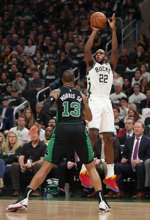 Bucks forward Khris Middleton shoots over Celtics forward Marcus Morris.