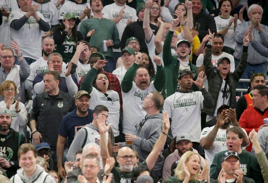 Fans cheer for the Bucks during a conference semifinal game against the Celtics at Fiserv Forum.