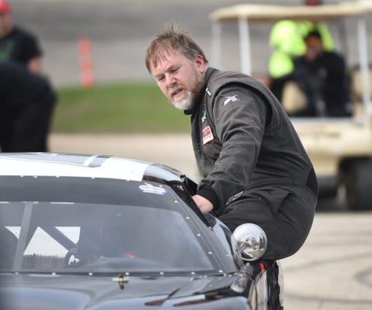 Dennis Prunty climbs back into his car for the second of two 50-lap features. He won the first and finished second to nephew Alex in the second.