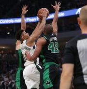 Bucks forward Giannis Antetokounmpo has his shot blocked by Celtics center Al Horford Sunday.