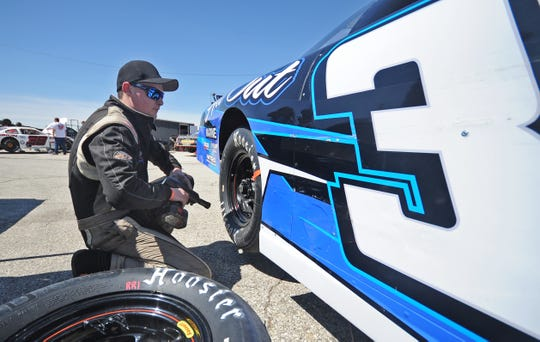 Zach Prunty changes tires on his late model between sessions. He is starting his first full season in the division.