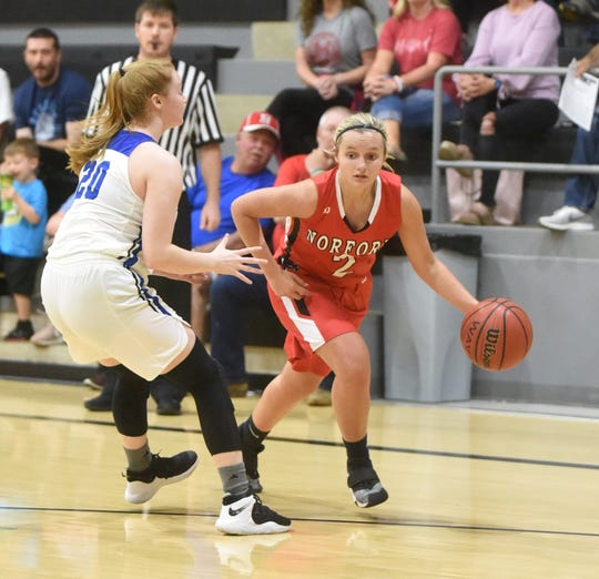 Norfork's Whitlee Layne drives past Mammoth Spring's Stephine Henry during the North Arkansas Senior Showcase on Saturday night at Izard County High School.
