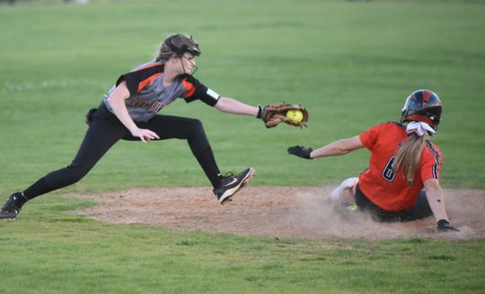 Calico Rock's Kenlee Killian reaches for Viola's Keyaira Moore at second base on Friday night.