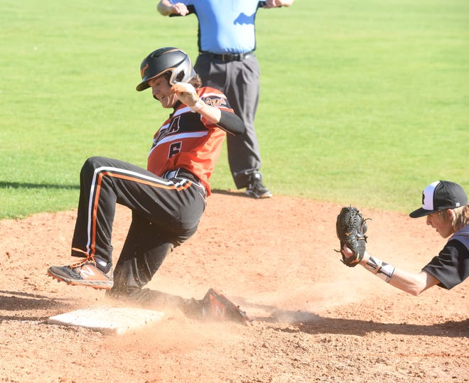 Viola's Dalton Roork slides safely into third base during a district semifinal game against Calico Rock.