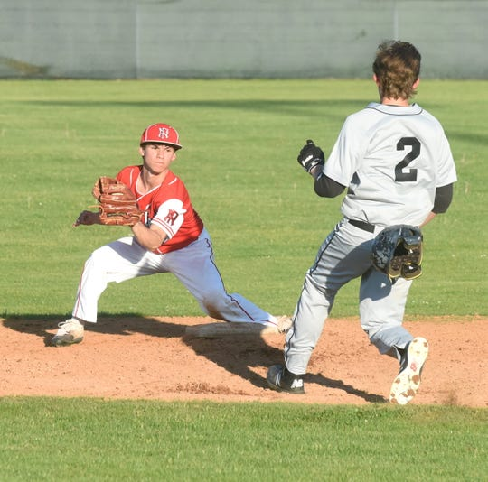 Norfork shortstop Bryson Thiel prepares to tag Izard County's Zach Simmons on Friday.