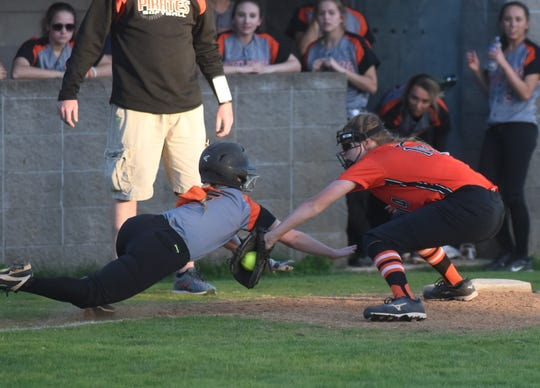 Viola's Lindsey Browning tags Calico Rock's Camryn Cook on a dive back to third base in the 1A-2 District championship game.
