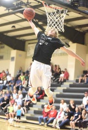 Calico Rock's Cole Whiteaker skies for a slam during the dunk contest at the North Arkansas Senior Showcase on Saturday night.