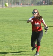Norfork's Eva Maple throws to first base for an out.